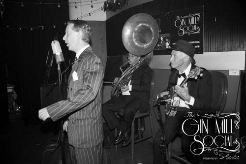 Greg Poppleton and the Bakelite Broadcasters open the Gin Mill Social. Greg Poppleton is Australia's only authentic 1920s singer. Geoff Power plays the sousaphone and trumpet, Sydney Jazz Club favourite Paul Baker is on banjo.