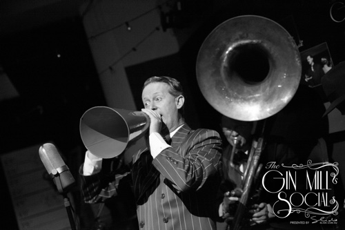 Greg Poppleton crooning through his 1920s megaphone with Geoff Power on sousaphone