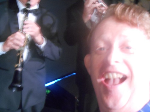 Band leader and 1920s singer, Greg Poppleton, takes a selfie