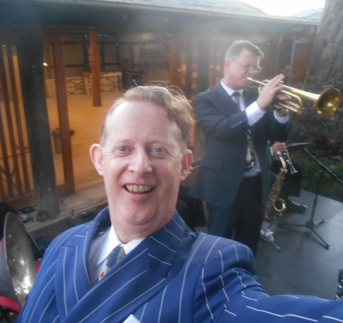 1920s singer and band leader Greg Poppleton takes a selfie while Geoff Power solos on trumpet.