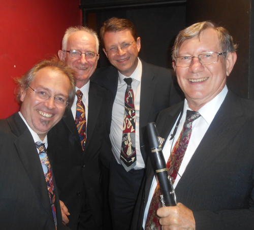 The Bakelite Broadcasters just about to go on stage. L-r Adam Barnard drums and washboard, Grahame Conlon guitar and banjo, Geoff Power sousaphone, cornet and trombone, Paul Furniss clarinet and alto sax.