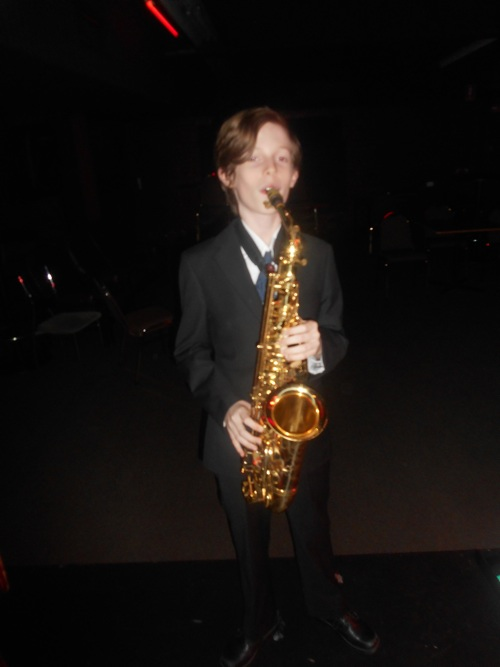 Damon Poppleton on alto sax. He turned 14 at the Builders Club on Sunday.
