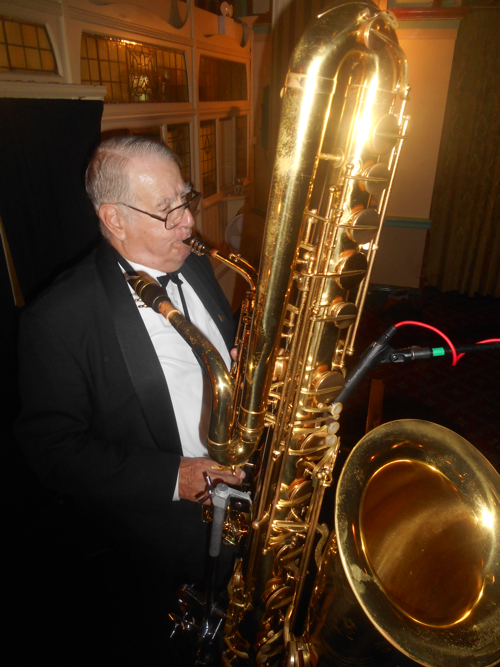 Jim Elliot is Sydney's undisputed master of the bass saxophone. He also plays beautifully authentic 1920s melodies on the alto sax and clarinet in Greg Poppleton and the Bakelite Broadcasters.