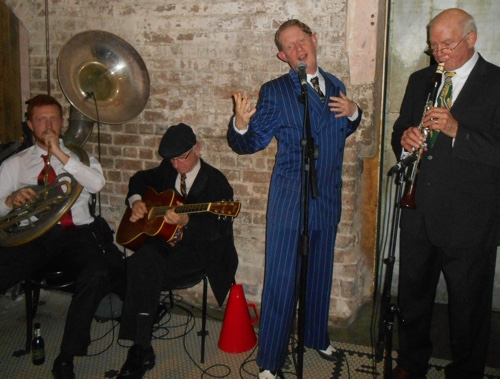 Greg Poppleton 1920s Quartet: Greg Poppleton authentic 1920s-1930s singer in blue. Glenn Henrich clarinet, Grahame Conlon guitar and Greg Chilcott sousaphone.