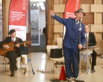 Greg Poppleton 1920s - 1930s singer at the Transport Expo. Grahame Conlon guitar and Adam Barnard drums and washboard.