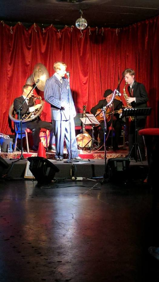 Swing Night with Greg Poppleton at Django Bar. Greg Poppleton (blue-striped suit 1920s-30s swing vocals) Geoff Power (sousaphone doubling cornet) Grahame Conlon (guitar doubling banjo) Damon Poppleton (alto sax).