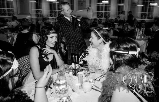 Greg Poppleton, authentic 1920s singer, serenading a table of flappers.