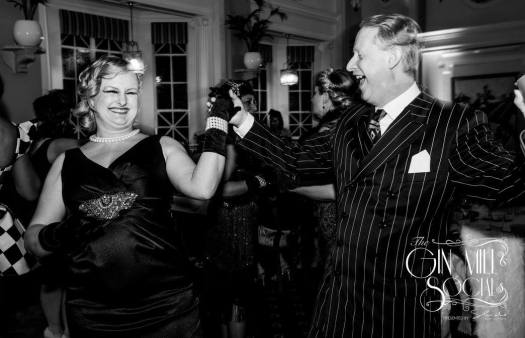 Australia's only authentic 1920s singer, Greg Poppleton, dancing with beautifully dressed guests at Sydney's 1920s Gin Mill Social