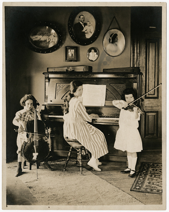 The young Boswell Sisters performing at home as a classical trio in 1918.