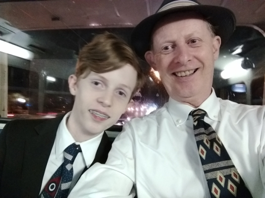 Damon and Dad on the way home after the gig in the back of an old Atlantean bus