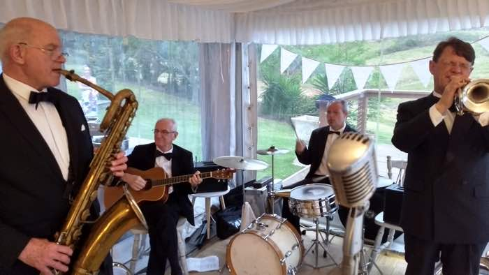Greg Poppleton's band of red hot 1920s-30s jazz musicians. (L-r) Glenn Henrich soprano, alto, baritone sax, clarinet and piccolo, Grahame Conlon guitar and banjo, Adam Barnard drums and washboard, Geoff Power trumpet and sousaphone.
