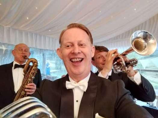 Greg Poppleton is Australia's only authentic 1920s-30s singer. Left, Glenn Henrich baritone sax. Right, Geoff Power trumpet.