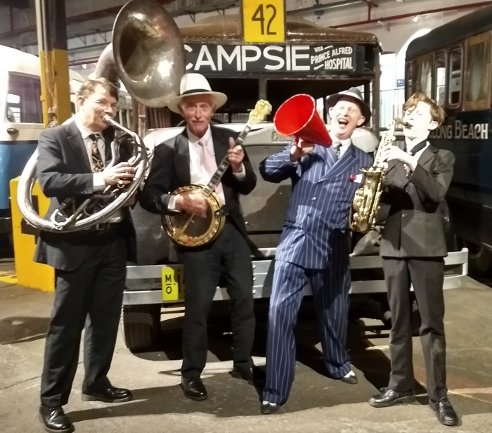 Greg Poppleton 1920s-30s Band. Geoff Power sousaphone doubling trumpet, Paul Baker banjo, Greg Poppleton 1920s-30s singer, Damon Poppleton alto sax.