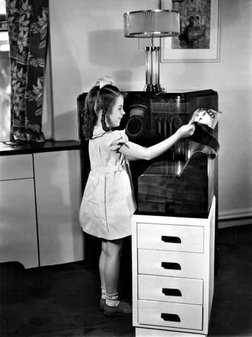 So easy to use, even a child can operate it. A 1938 publicity photo shows a Finch home printer receiving a facsimile newspaper from WWJ in Detroit. (Detroit News Archives)