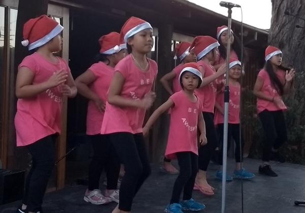 The Karen children's choir danced to Christmas songs.