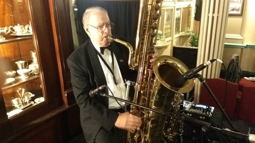 Jim Elliott doubled bass and alto saxophones