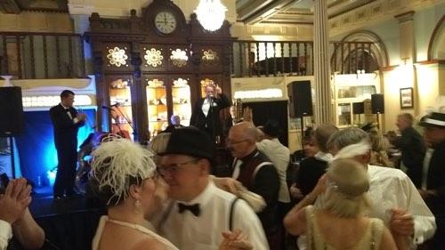 Greg Poppleton 1920s Quartet in the Grand Dining Room for the Great Art Deco Ball. (L-r) Geoff Power trumpet and sousaphone, Greg Poppleton (1920s singer) Grahame Conlon (guitar and banjo) Jim Elliot (alto and bass sax).