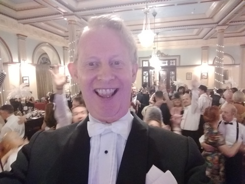 Greg Poppleton taking a selfie and being 'photo-bombed' by happy dancers.