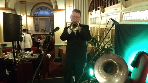 Geoff Power with Greg Poppleton's band doubled trumpet and sousaphone.