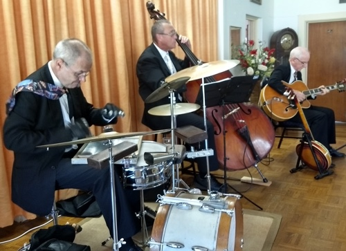 The Greg Poppleton swing rhythm section. Adam Barnard drums and washboard, Dave Clayton double bass, and Grahame Conlon guitar and banjo