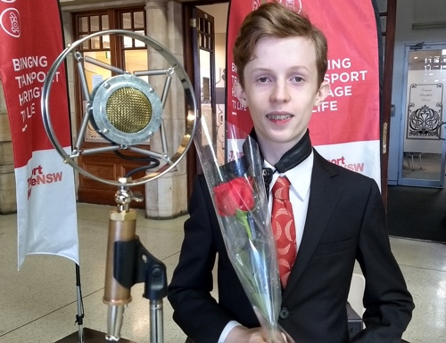 Damon Poppleton holding the red rose the band was given.