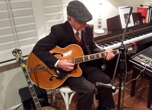Grahame Conlon with his jazz guitar playing the 1936 hit 'The Way You Look Tonight' in Greg Poppleton's trio