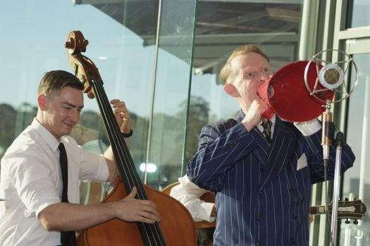 Greg Poppleton singing through the red 1920s megaphone