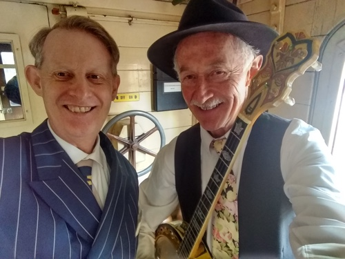 Greg Poppleton 1920s singer and Paul Baker banjo in the Guards Van of The Hydro Express