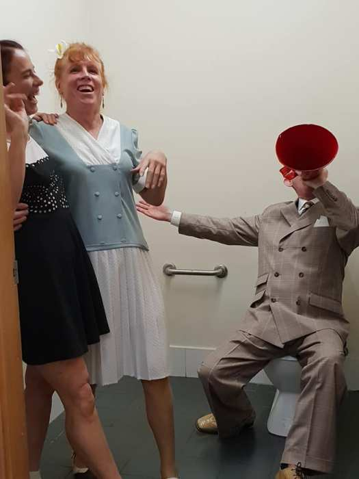 Greg Poppleton 1920s singer and swing dancers in toilet