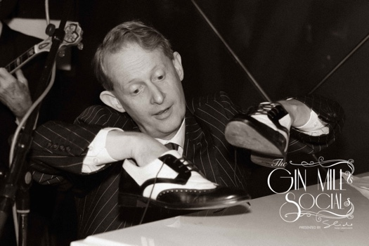 Greg Poppleton using his shoes as percussion on the piano as his 1920s Trio solos.