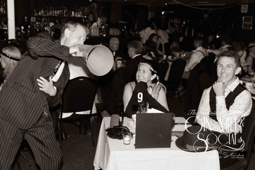 Greg Poppleton sings through his 1920s megaphone to a happy couple