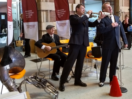 Greg Poppleton singing, Geoff Power Cornet, Grahame Conlon guitar at the 2019 Transport Heritage Expo.