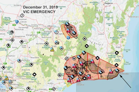 "Map showing warning areas near bushfires in Victoria, Australia. The areas with a black line and grey fill are designated for evacuation. The red lines indicate ""emergency warning"". The arrow points toward Mallacoota, Victoria. The width of the largest emergency warning area is approximately 204km (110 miles), east to west. Map by Vic Emergency, Dec. 31, 2019"